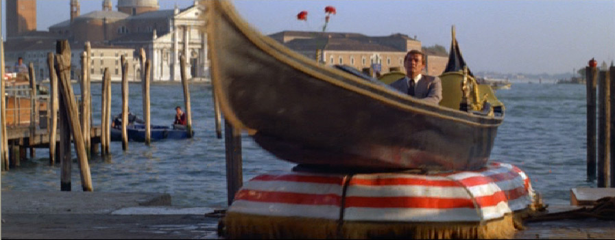 Roger Moore changed costumes five times before he managed to come up md car from the water at St Markusplts in Venice.