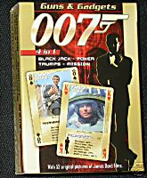 Guns & Gadgets  James Bond 007 Heroes & Villians 4 in 1 Playing Cards    The are some of the finest cards you are ever likely to own. Not only are they fantastic quality and value, they also come in a neat collectable tin. One of the two decks feature the 'Heroes and Villains' of the bond films including Jaws, Blofeld, the Bond girls and Bond himself. The other deck features the 'Guns and Gadgets' including many of Qs gadgets along with those used by the villains. Each of the cards give values for different attributes such as damage, strength etc (you know how it works) for use in the trumps game. Also included are a secret viewfinder to read hidden text on the back of the cards and a booklet of instructions for various games. The gilt edging of the cards gives them a real quality and expensive feel. The tin features the bond logo on the lid in a raised up outline and a felt inner case to hold the cards in place. Complete with a neat certificate of authenticity showing the limited edition number out of 5000 this item is well worth the money even if it was